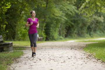 Fit young woman jogging in a park