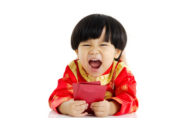 Asian boy lying on the floor holding red packets and laugh