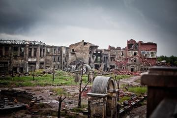 War devastation fear , scenery, wet, dirty, home town
