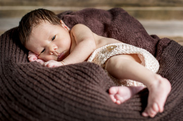portrait of a cute sleepy newborn