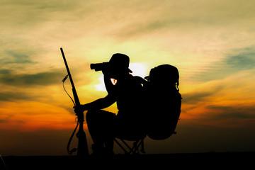 Sunset of hunter on desert