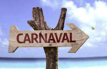 Carnival (In Portuguese) wooden sign with a beach on background