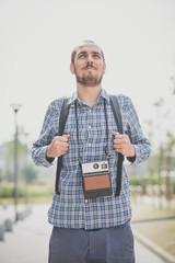handsome hipster casual multitasking modern man with vintage cam