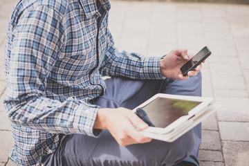 handsome hipster casual multitasking modern man using tablet