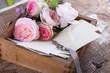 Obrazy na płótnie, fototapety, zdjęcia, fotoobrazy drukowane : Box with flowers  and old photos