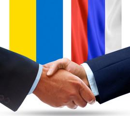 Representatives of Russia and Ukraine shake hands