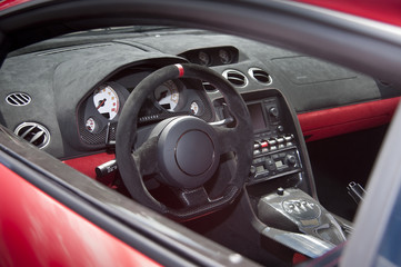 Exotic sportscar interior in suede leather and carbon fiber