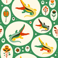 Seamless pattern with colorful crocodiles and flowers.