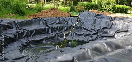 Construction d'un bassin de jardin - 72265597