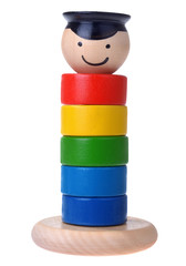 Pyramid build from colored wooden rings with a mans head