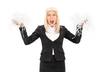 Outraged businesswoman holding a shredded document