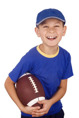 Young boy and rugby ball isolated on white background