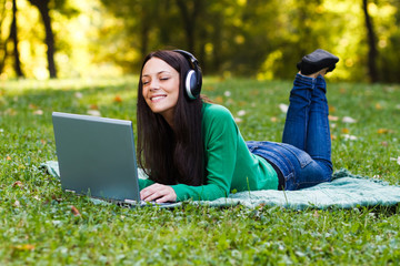 Woman enjoying music in park