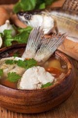 Fish soup in the wooden dish
