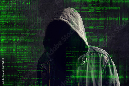 Faceless hooded anonymous computer hacker - 72269100