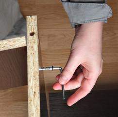 Furniture assembly, wood screw screwed manually using allen ke