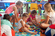 Children playing games in nursery - 72270343