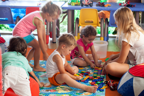 Leinwanddruck Bild Children playing games in nursery
