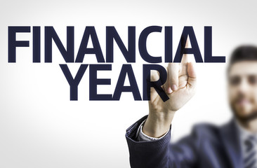 Business man pointing the text: Financial Year