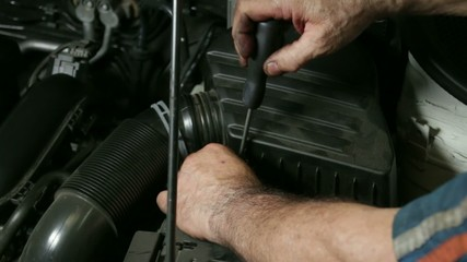 Car Repair Mechanic Screwing Automobile Air Filter