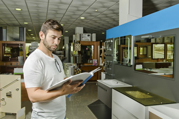 Man observes catalog store fixtures and bathrooms