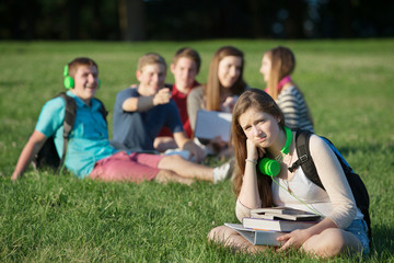 Frustrated Teen Near Group