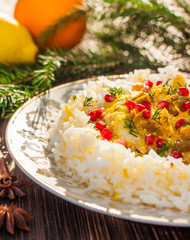 Rice with fish in orange sauce for a Christmas