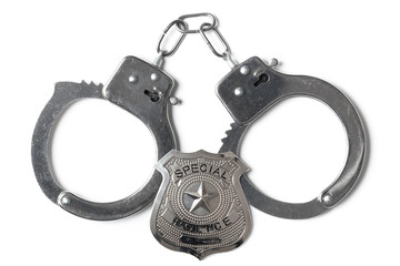 Police Badge and Handcuffs - Stock Photo