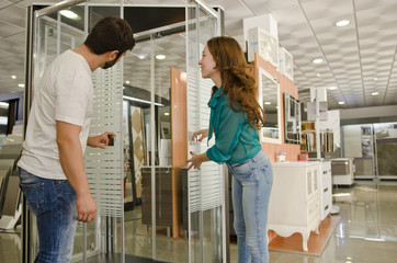 Woman and man looking shower enclosures