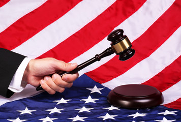 Gavel on Judge Hand over American Flag