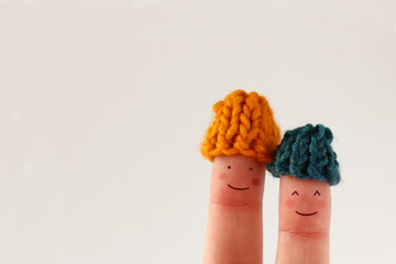 Funny finger people couple smiling winter hats