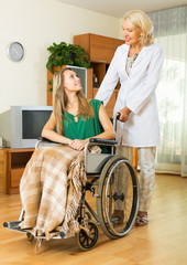 Physician and disabled girl communicating