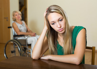Woman and handicapped female having quarrel