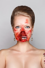 young woman with make-up zombies on Halloween in the studio