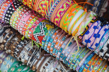 Colorful handmade bracelets made of beads and thread