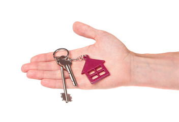 House keys in hand isolated on white background
