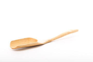 Wood spoon isolated placed