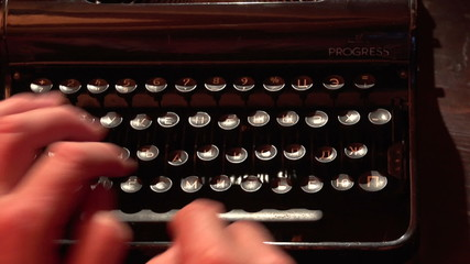man typing on a typewriter 5