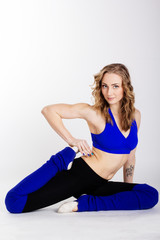 Young woman standing yoga pose