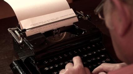 man typing on a typewriter 1