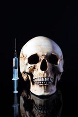 Syringe and human skull