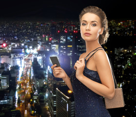 woman in evening dress with vip card