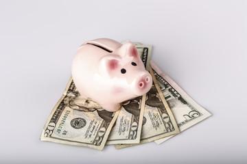 pig bank on dollar banknotes