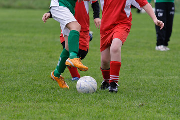 Young soccer player trying to take control of the ball