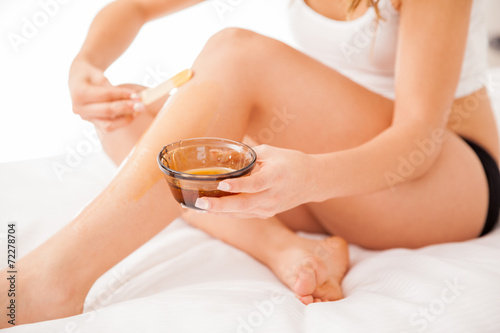 canvas print picture Closeup of wax hair removal