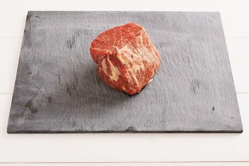 raw fresh beef steak on slate platter