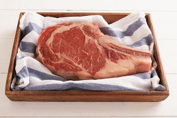 fresh beef steak in wooden tray