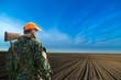 Male hunter looking at field during hunt season