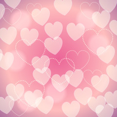 Pink romantic blurred background with bokeh hearts