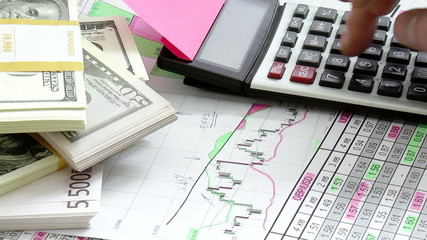 Graphs, charts, business table with banknotes